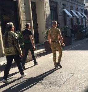 Trendy Italians walking down the street.